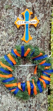 Henry Turner Jr.'s riding companions honored him with a Florida Gators-themed memorial at the spot where his motorcycle went off the stretch of U.S. Highway 129 known as 'The Dragon.'