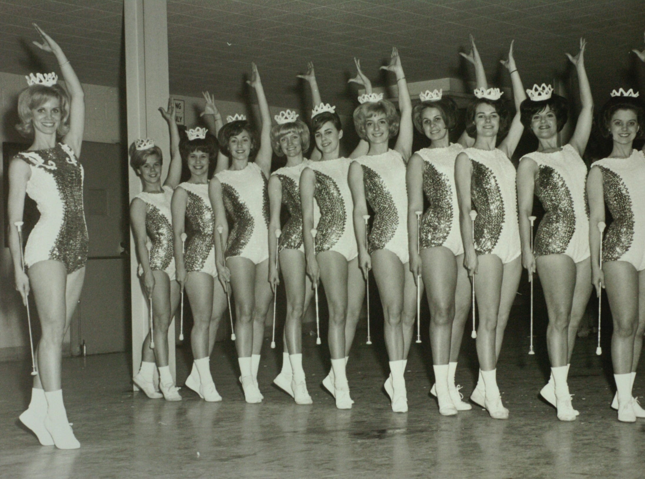 Judy Barton Cox at left during her days as a majorette at the University of Tennessee.  Cox is retiring after 40 years of service to the program.