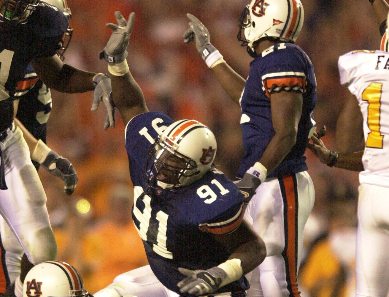 Auburn's DeMarco McNeil  (92) recovers a Vol turnover and stops a Tennessee drive on Saturday at Auburn.