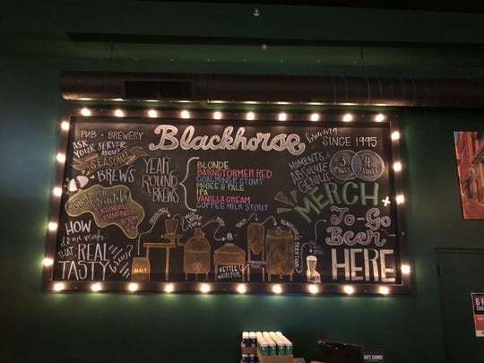 Blackhorse Pub and Brewery lists its year-round brews, like the Barnstormer Red and Coffee Milk Stout, on an over-sized chalkboard by the entrance.