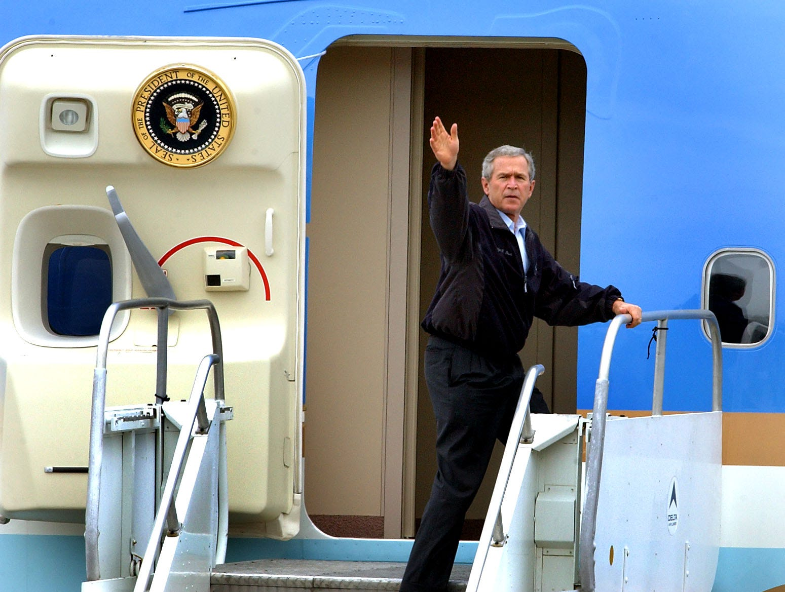 President George W. Bush waves goodbye from Air Force One Friday, April 22, 2005, at McGhee Tyson Air National Guard Base. Bush journeyed to East Tennessee to celebrate Earth Day in Cades Cove, a visit which was cut short by bad weather.