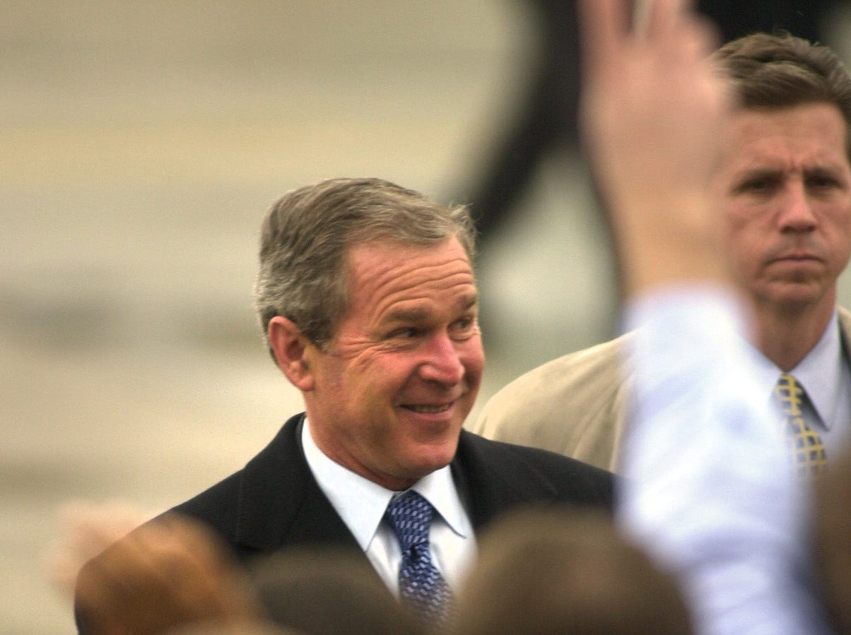 President George W. Bush is greeted by 300 South-Doyle Middle School students Wednesday, Feb. 21, 2001, at McGhee Tyson Air National Guard Base.