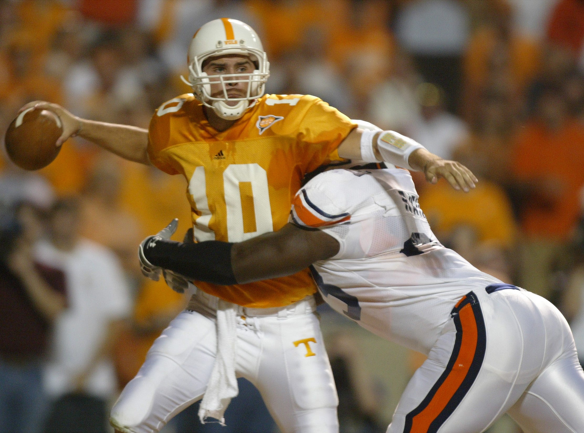 Tennessee quarterback Erik Ainge gets off a pass from his own end zone despite pressure by Auburn defensive tackle Jay Ratliff on Saturday at Neyland Stadium. Tennessee was beaten 34-10 by the Tigers. 10/02/04