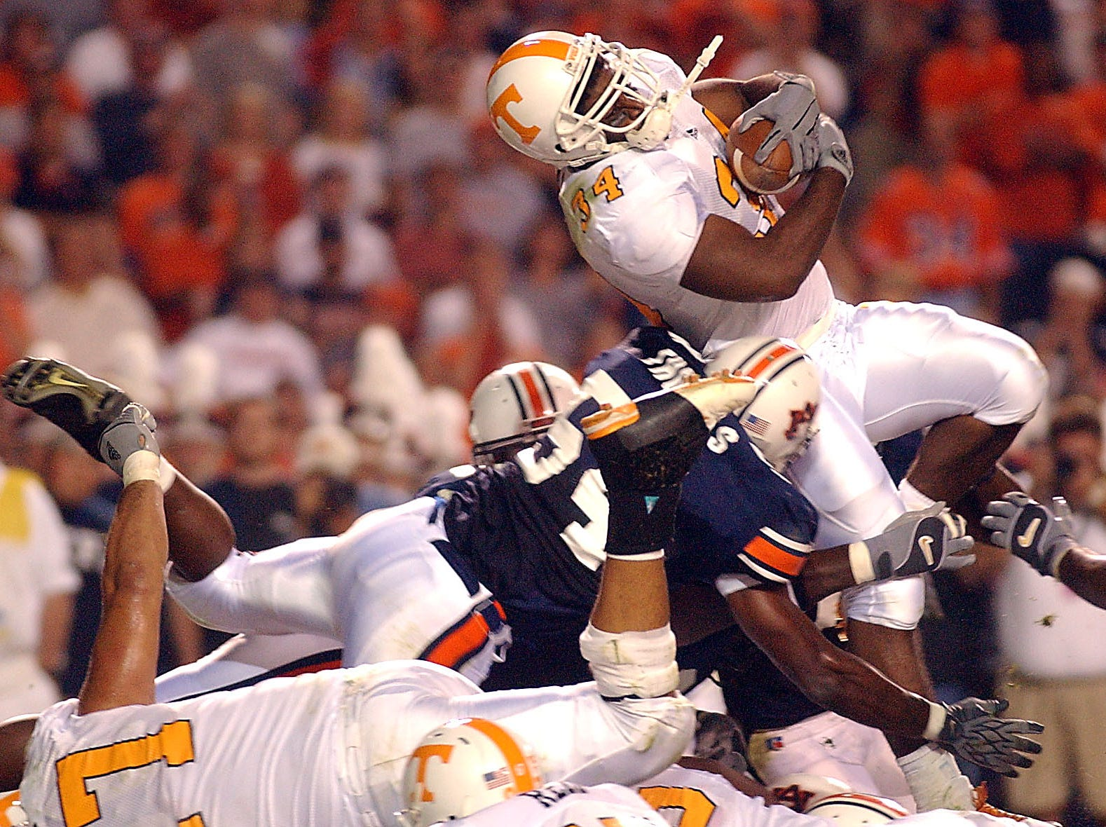 Tennessee's (34) Jabari Greer dives over the goal line for Tennessee's first touchdown at the end of the first half  Saturday night in Auburn, Alabama.    10/4/2003