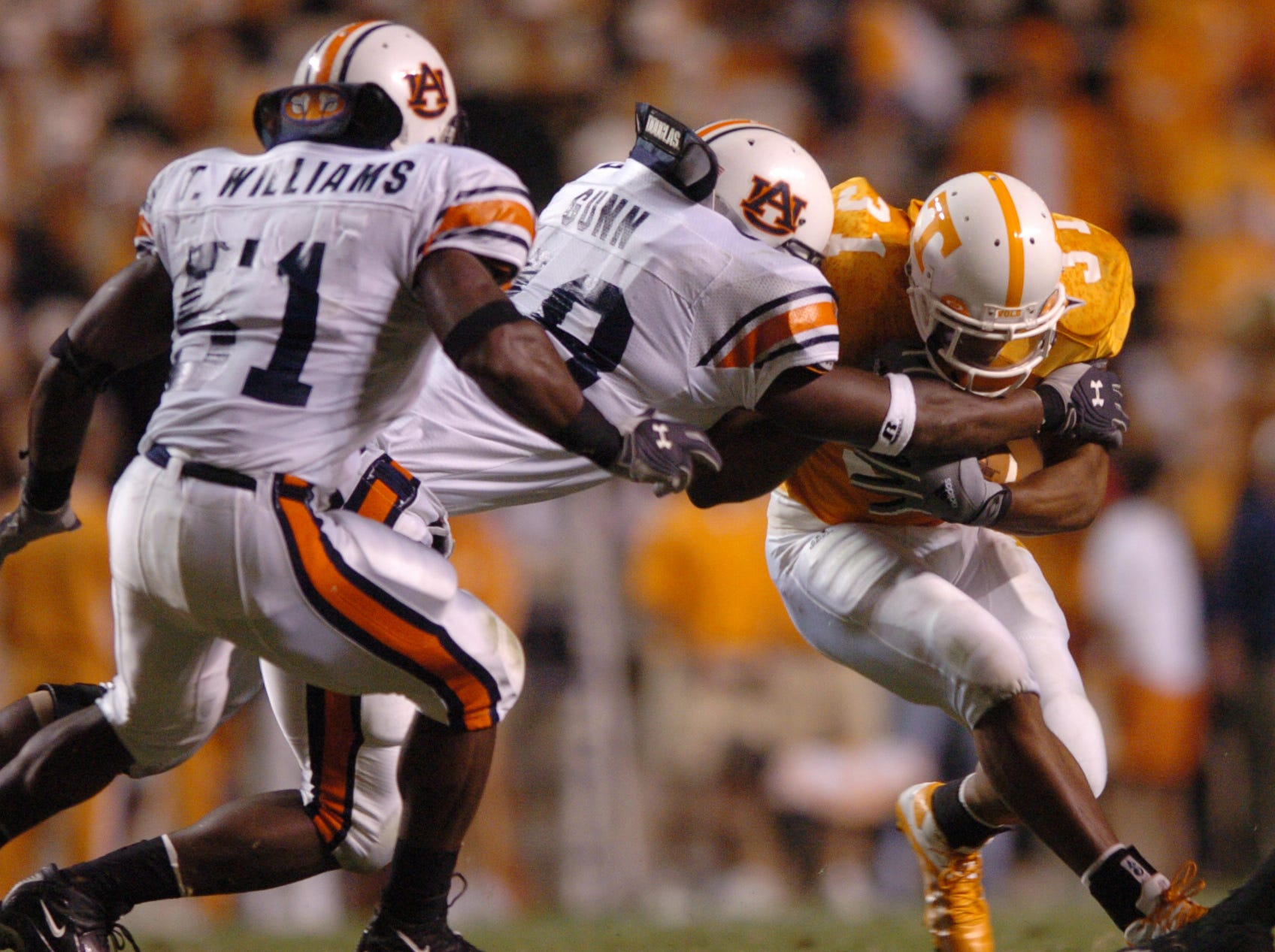 UT's Gerald Riggs (31) can't get past Auburn's Travis Williams and Marquis Gunn in Neyland Stadium. 10/02/2004