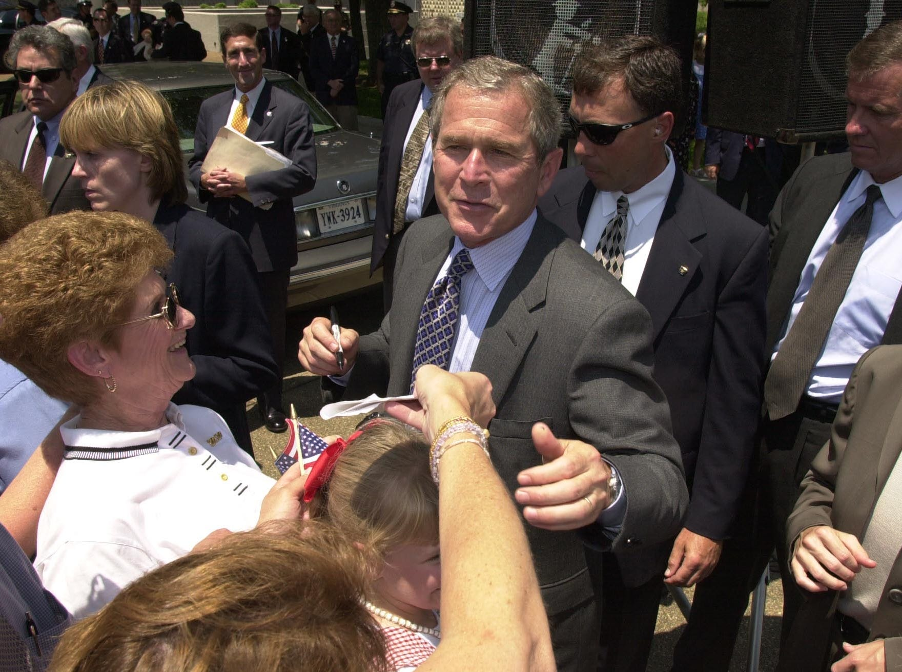 Texas Governor George W. Bush talks to supporters and signs autographs during his campaign stop Thursday at the Civic Auditorium Plaza.  2000.