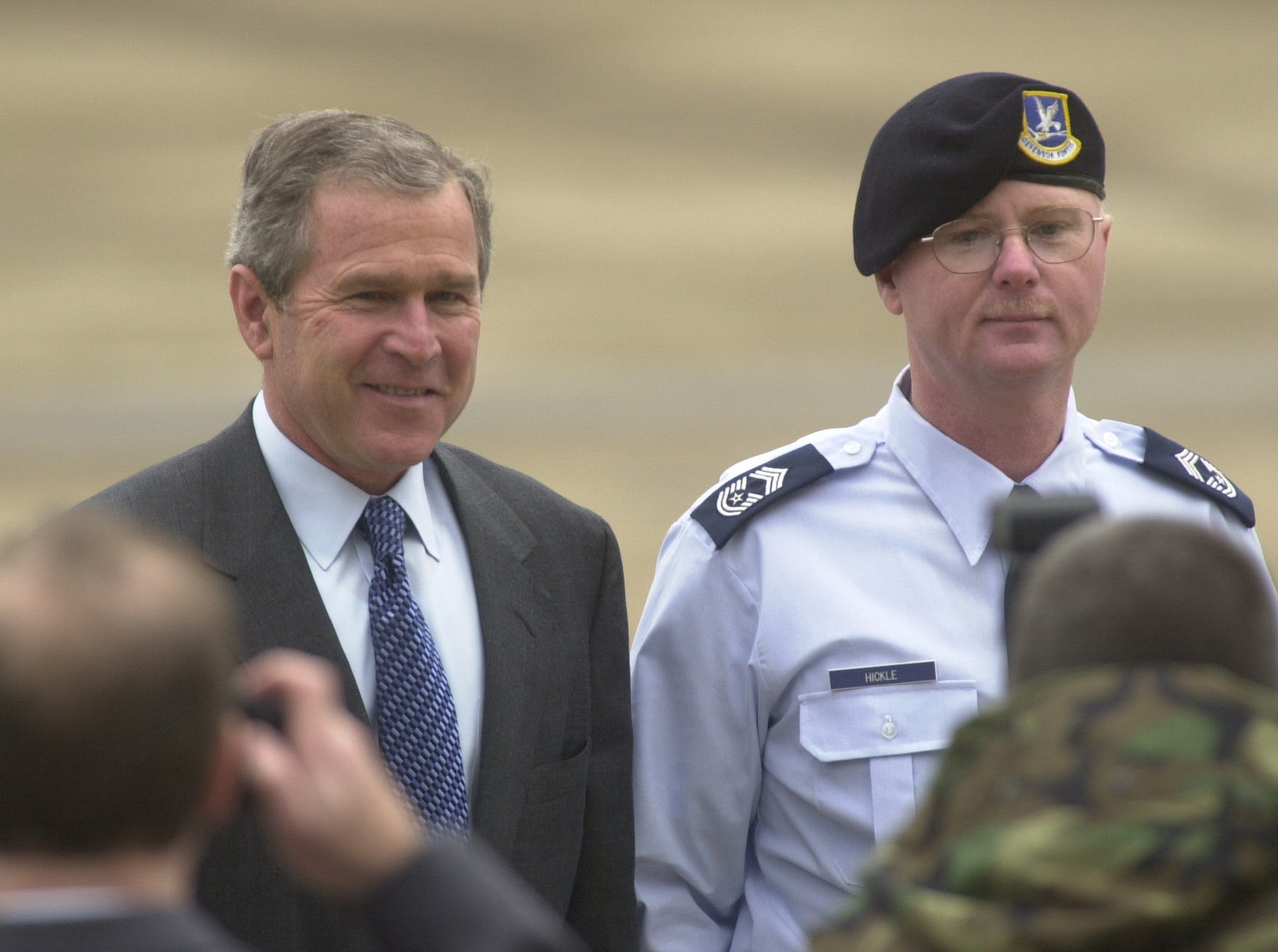 President George W. Bush stands with  Chief Master Sgt. Terry Hickle after promoting him Wednesday at McGhee Tyson Airbase. Hickle, the chief of security for the 134th Air Refueling Squadron, was promoted from senior master sargeant in a brief ceremony before Bush departed the airbase. 2001.