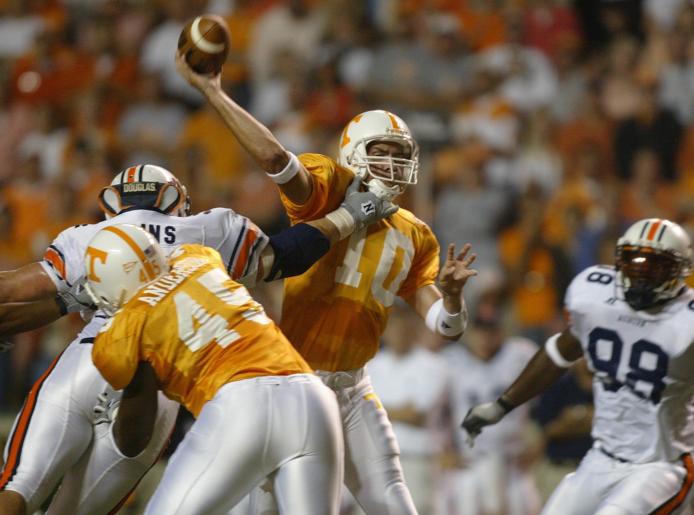 Tennessee quarterback Erik Ainge is pressured by Auburn defensive end Bret Eddins Saturday at Neyland Stadium. Fullback Cory Anderson blocks on the play. 10/02/04