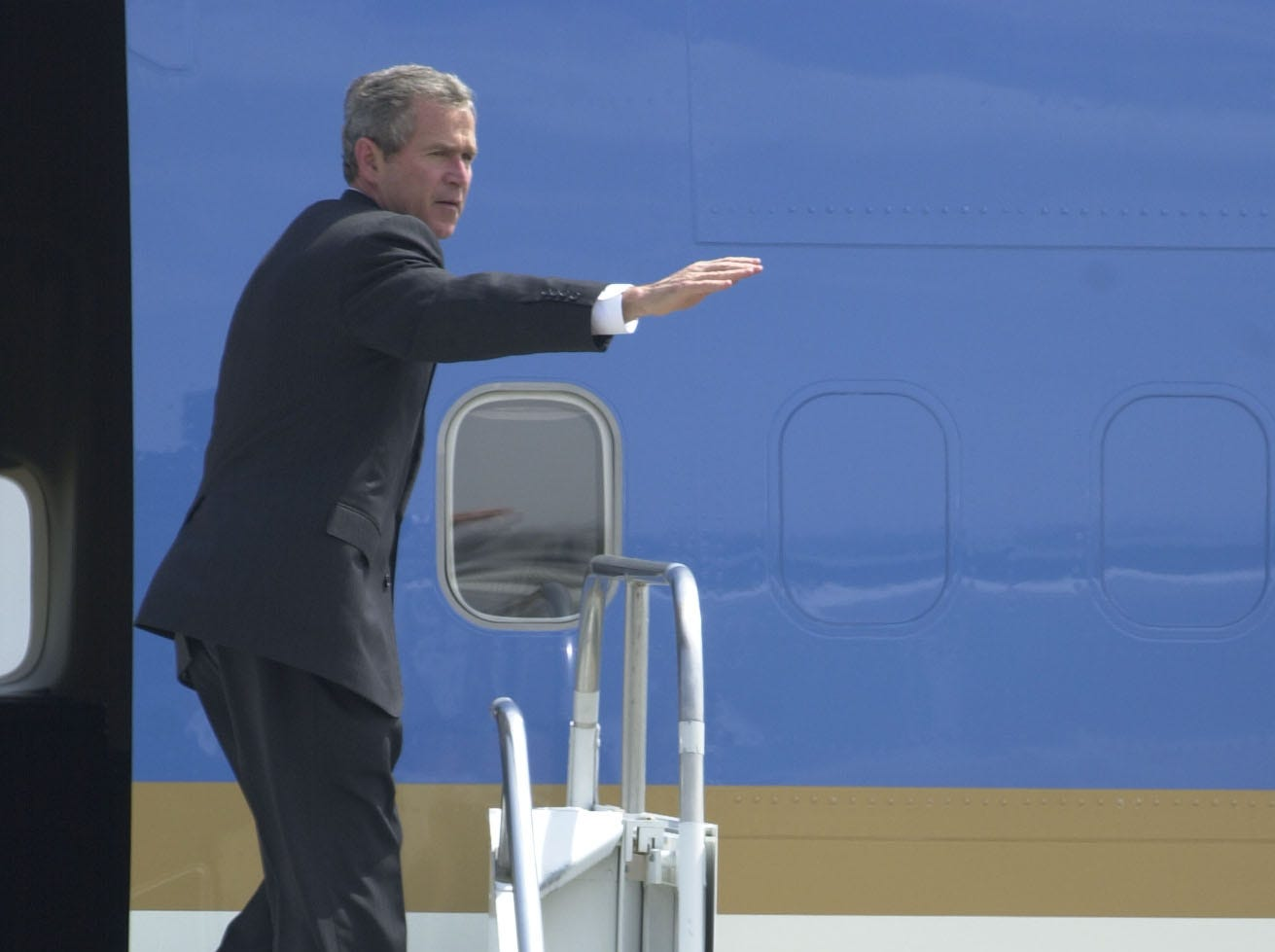 President George W. Bush waves goodbye from Air Force One April 8, 2002, at McGhee Tyson Air National Guard Base, after a visit and speech at the Civic Coliseum.
