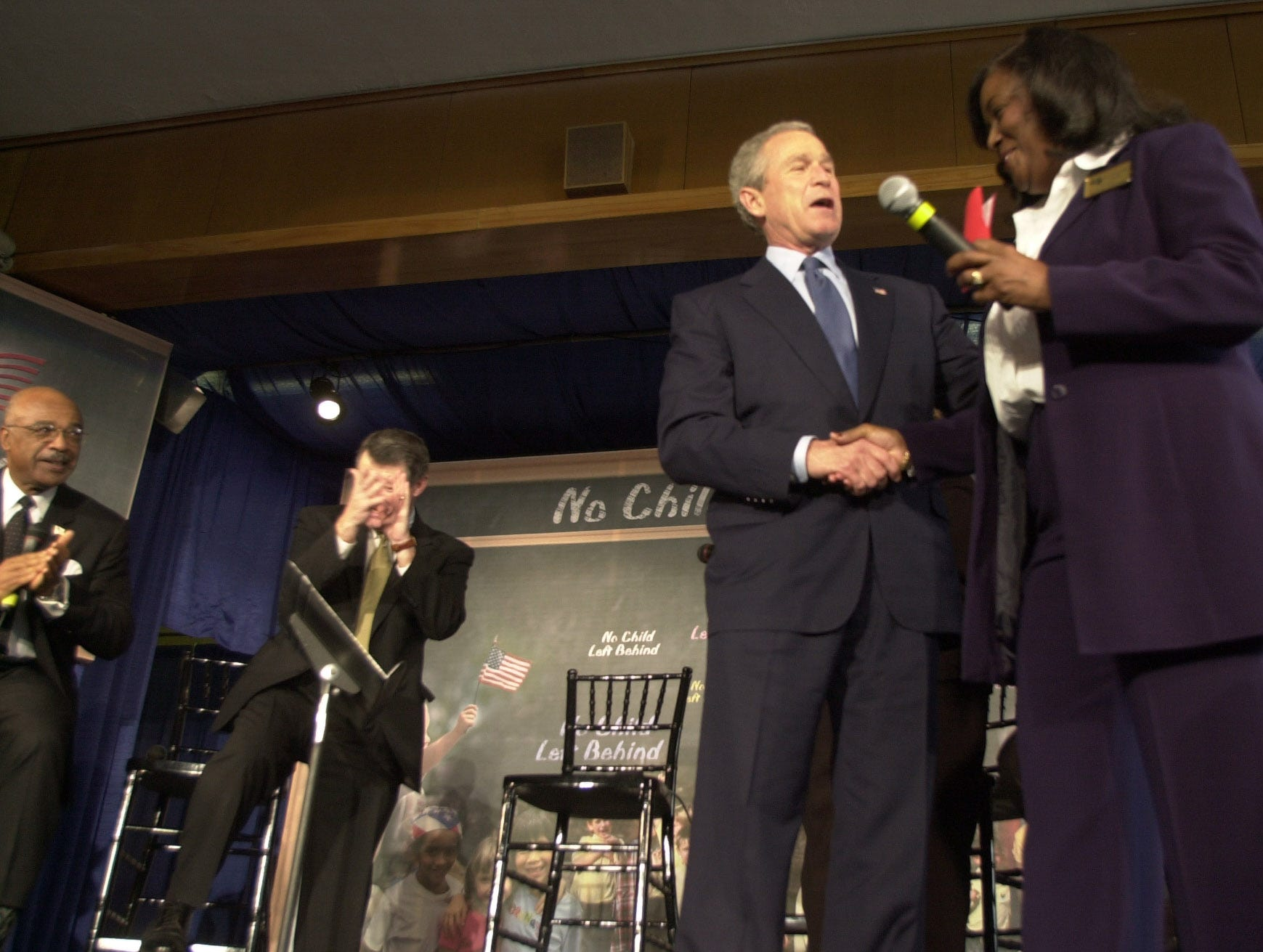 """President George W. Bush is greeted by West View Elementary Principal Melvenia Smith during a visit Thursday, Jan. 8, 2004, to celebrate the second anniversary of the No Child Left Behind Act. """"This school had been measured as a school that hadn't been performing the way you wanted,"""" Bush said. """"Now it is exemplary in math, above standards in reading. You are accomplishing that which we all want, and this is that not one single child be left behind in the state of Tennessee and the city of Knoxville."""""""