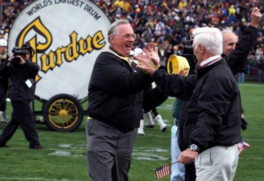 -  -By Frank Oliver/Journal and Courier --- Neil A. Armstrong, left, high fives fellow Apollo astronaut Eugene A. Cernan on October 23, 1999 after Armstrong banged the Purdue drum during halftime ceremonies of the Penn State game. The festivities honored 18 astronauts that graduated from Purdue in West Lafayette. Armstrong was the first man to walk on the moon, while Cernan has been the last.