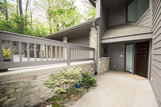 This home just off Happy Hollow Road offers privacy among the city and as much natural light as you can take in.