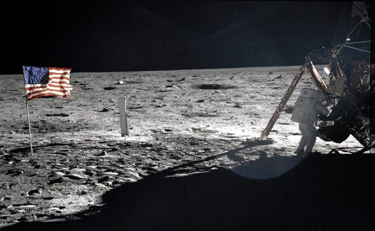 """This July 20, 1969, file photo provided by NASA shows Apollo 11 astronaut Neil Armstrong on the lunar surface. This weekend marks the 45th anniverary of the landing.  File photo/APFILE - This July 20, 1969 file photo provided by NASA shows Apollo 11 astronaut Neil Armstrong on the lunar surface. Apollo 11 astronauts trained on Earth to take individual photographs in succession in order to create a series of frames that could be assembled into panoramic images. This frame from Aldrin's panorama of the Apollo 11 landing site is the only good picture of mission commander Neil Armstrong on the lunar surface. Armstrong and fellow astronaut Edwin """"Buzz"""" Aldrin spent nearly three hours walking on the moon, collecting samples, conducting experiments and taking photographs. In all, 12 Americans walked on the moon from 1969 to 1972.  (AP Photo/NASA, Buzz Aldrin, File)"""