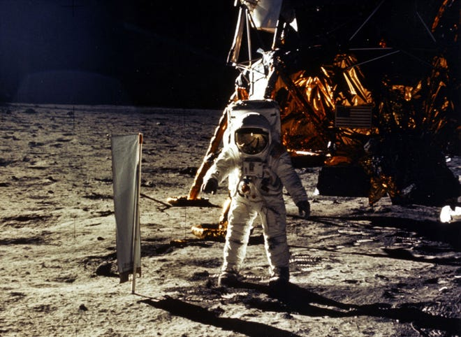 The deployment of scientific experiments by astronaut Edwin ?Buzz? Aldrin Jr. is photographed by astronaut Neil Armstrong. Man?s first landing on the moon occurred July 20, 1969, as Lunar Module ?Eagle? touched down  on the Sea of Tranquility on the east side of the moon. File photo/Getty Images