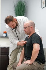 Dr. Rossitter consults with a patient at Total Health Clinic in Lafayette.