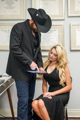Dr. Chad Rossitter consults with his wife Isabella at the Total Health Cininc.