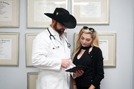 Dr. Chad Rossitter with wife Isabella at the newly opened Total Health Clinic