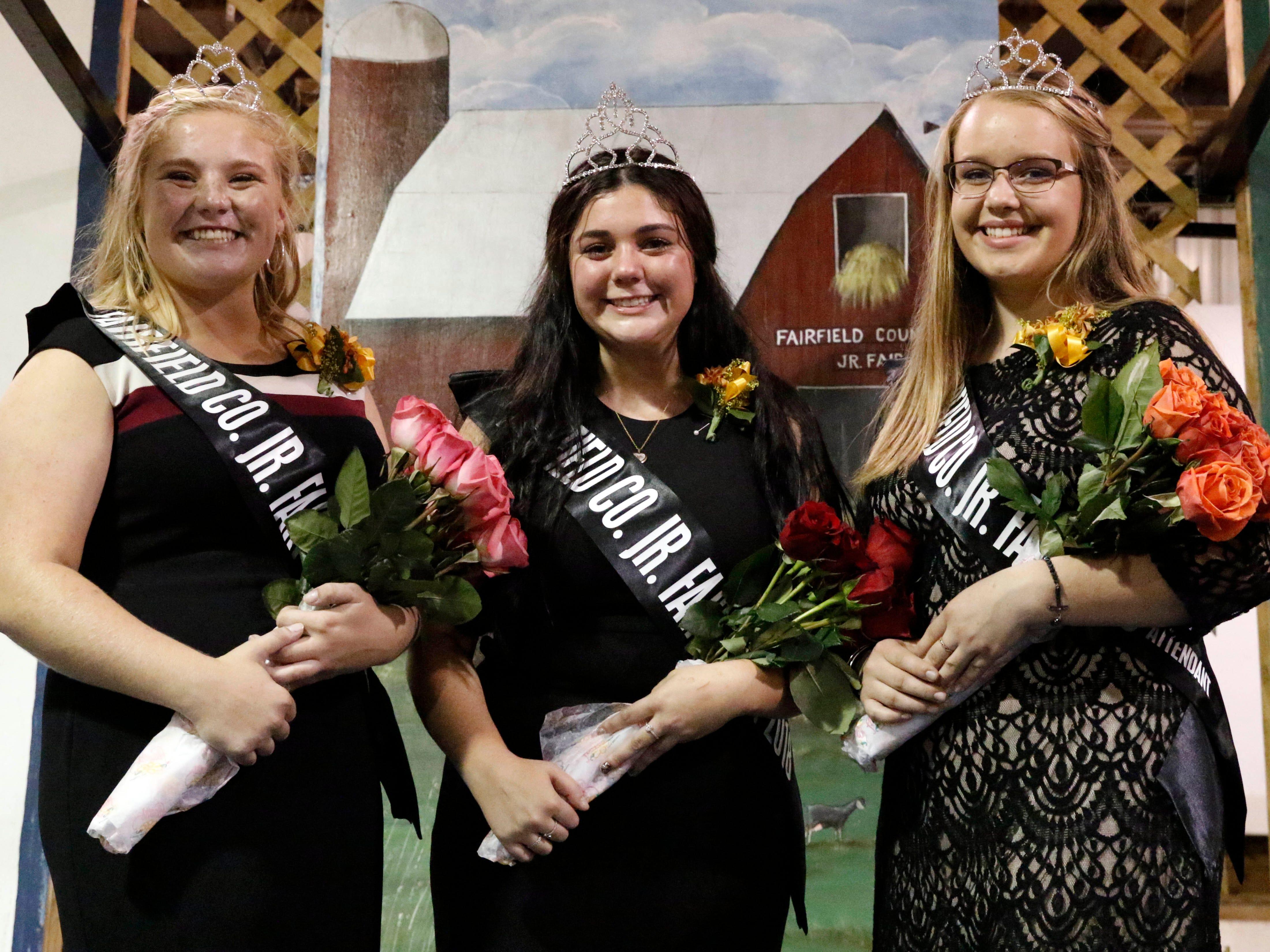Hayley Richardson, center, the 2018 Junior Fair Queen stands between Second Attendant Tatum Campbell, left, and First Attendant Allie Poston.