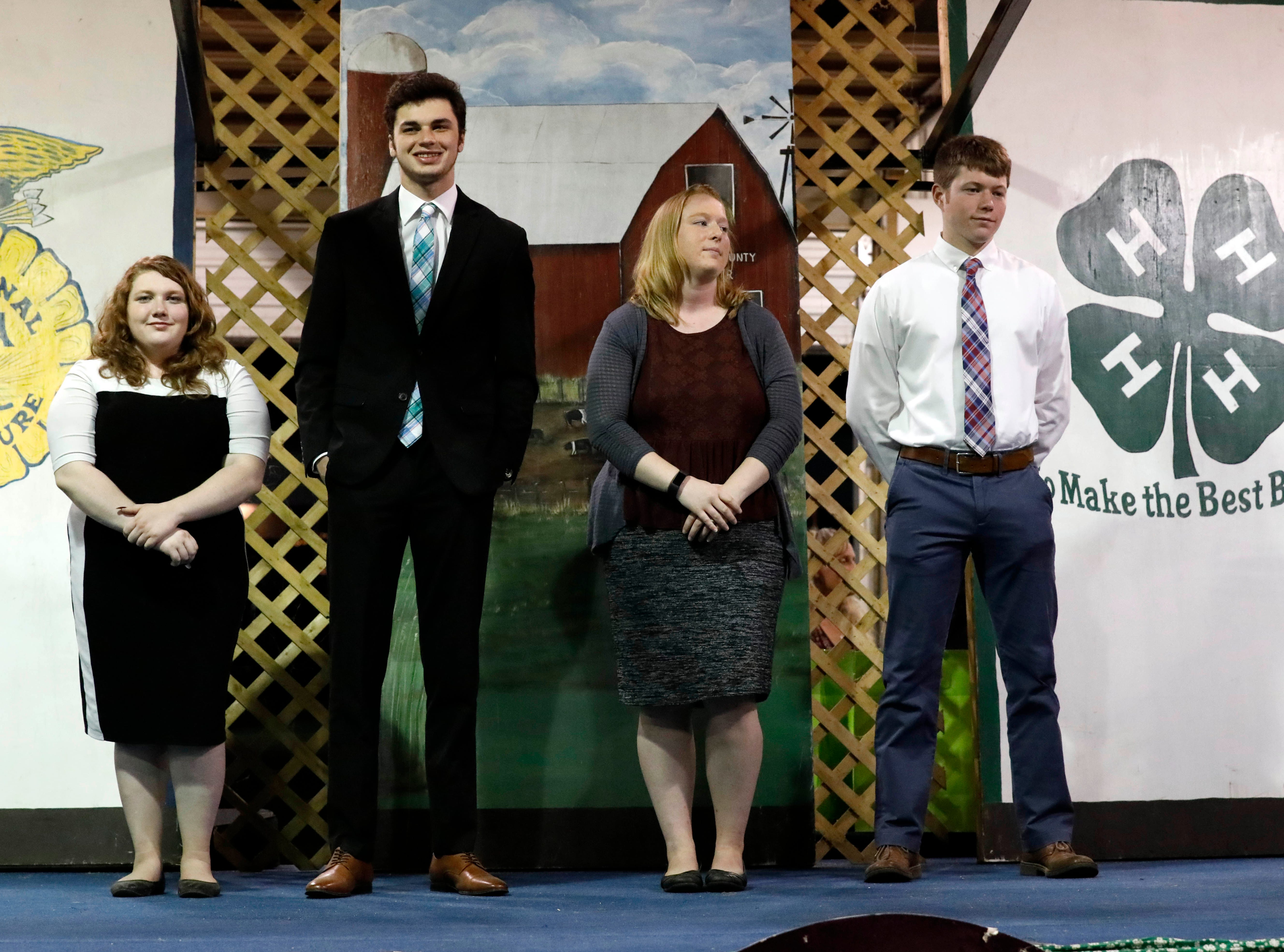 (left to right) Sara Doner, Grant Molnar, Hannah Queen and Evan Young were recognized as outstanding 4-H'ers Sunday night, Oct. 7, 2018, during the Junior Fair Panorama at the Fairfield County Fair in Lancaster.