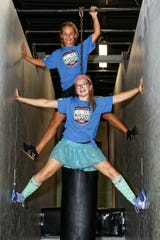 Riley Porter (top) of South Lyon and Carli Snook of Dimondale train in Howell and competed on American Ninja Warrior Junior.