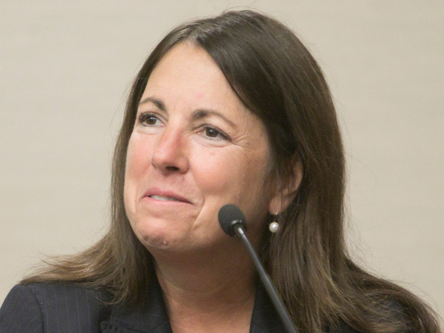 Judge Theresa Brennan smiles as she recounts how she came to be District Court judge Monday, Oct. 8, 2018 during an evidentiary hearing held by the Michigan Judicial Tenure Commission.