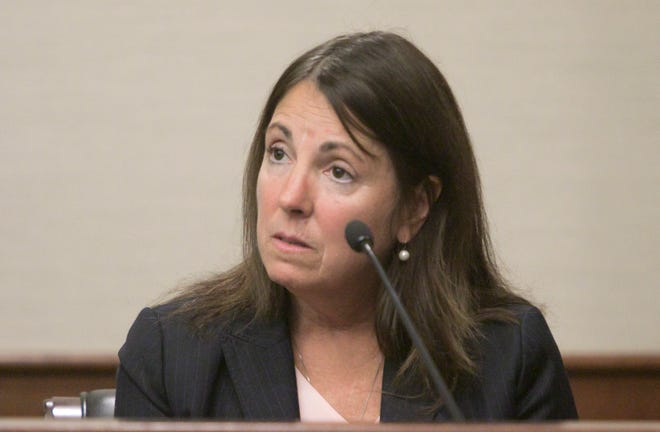 Judge Theresa Brennan responds to questions from her attorney Dennis Kolenda Monday, Oct. 8, 2018 during day six of a Judicial Tenure Commission hearing.