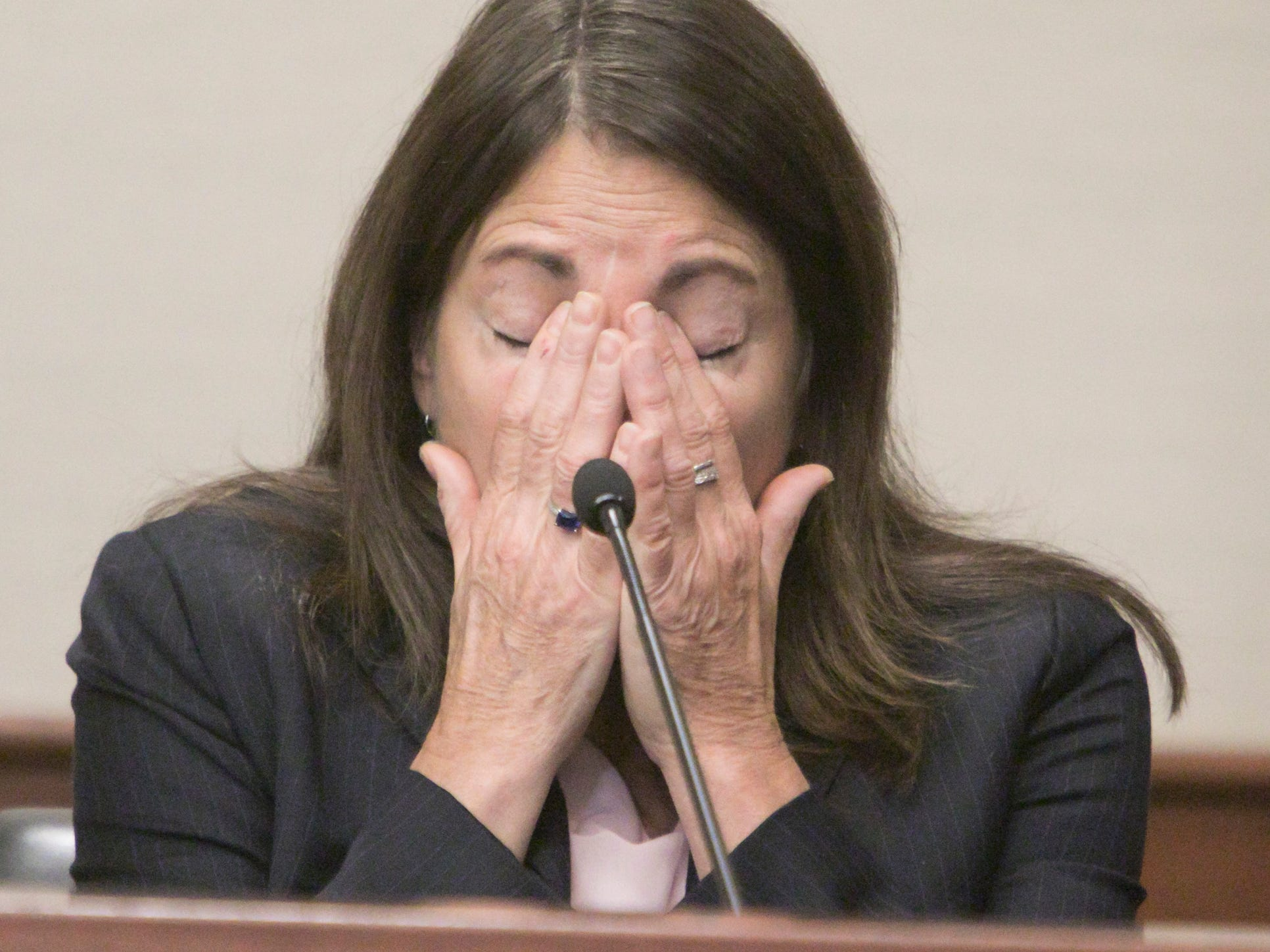 Judge Theresa Brennan reacts when asked to look back on her divorce from husband Don Root during the JTC hearing Monday, Oct. 8, 2018.
