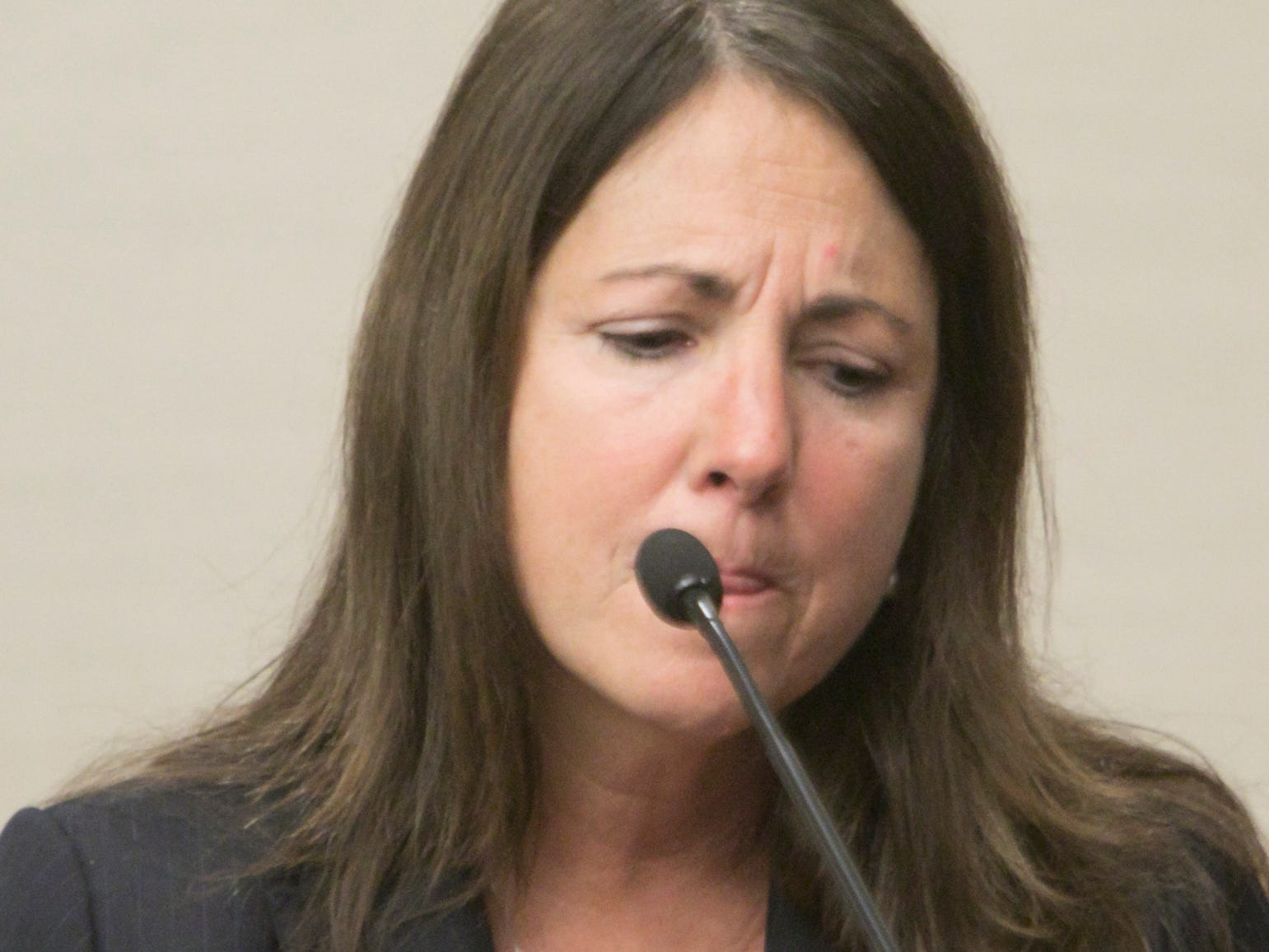 Emotion crosses the face of Judge Theresa Brennan as she recounts her early experience both as an attorney and later as District Court judge during Judicial Tenure Commission hearing testimony Monday, Oct. 8, 2018.