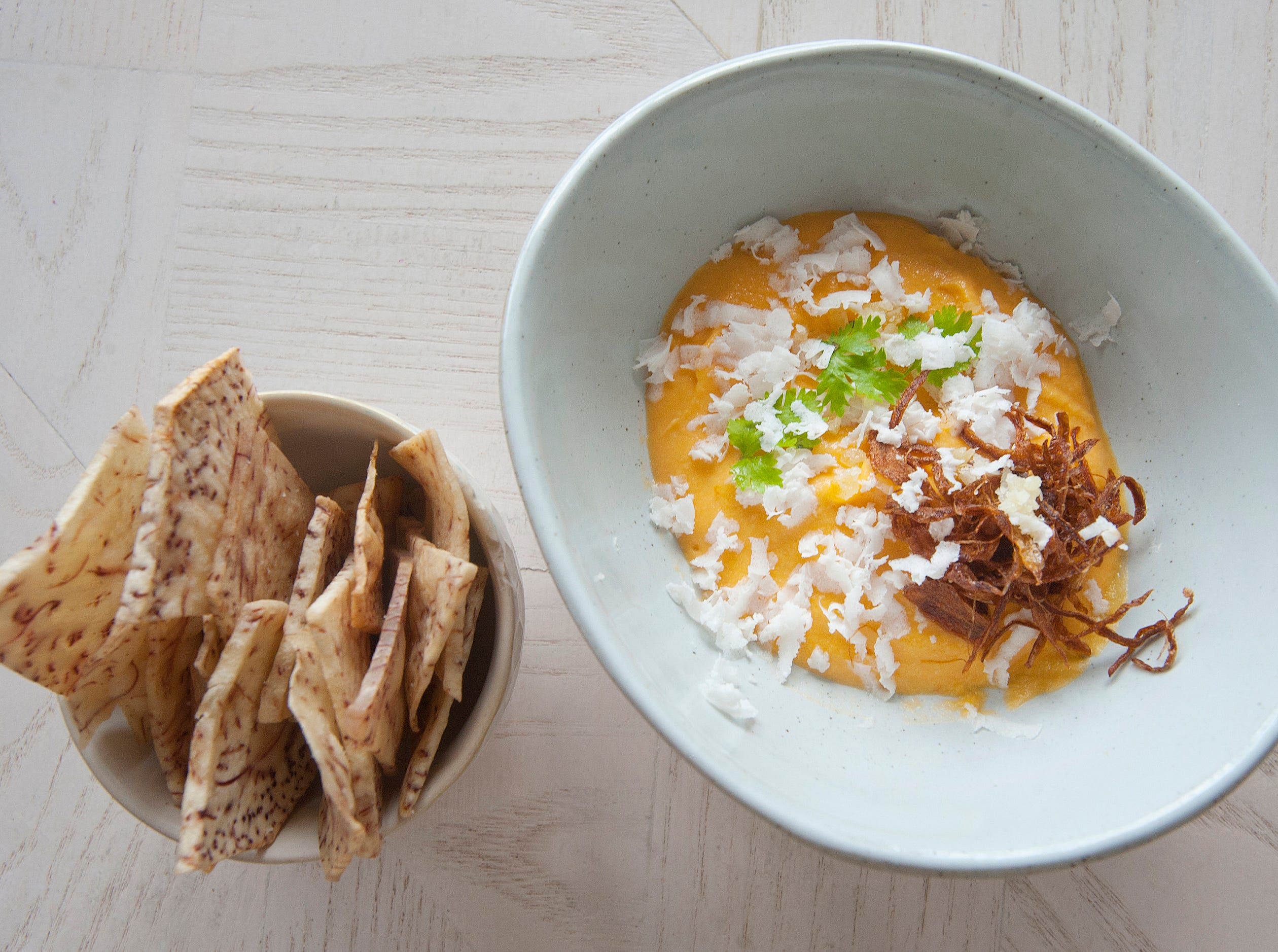 Naive's Thai butternut squash dip is made by blending oven-roasted squash, cashews, a touch of sesame seed oil and Thai chili paste.  It is then topped with coconut ricotta cheese, cilantro and crispy shallots. The dish is served with taro toot chips.September 20, 2018