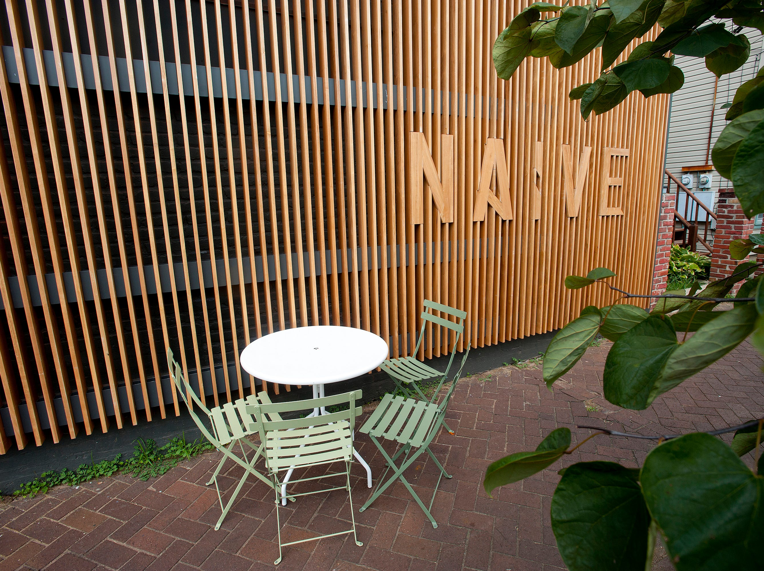 Sidewalk seating in front of Naive, a restaurant on E. Washington St.September 20, 2018