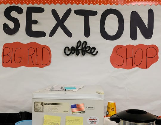 Signage for the Sexton Big Red Coffee Shop is on display in the classroom Monday, Oct. 8, 2018.