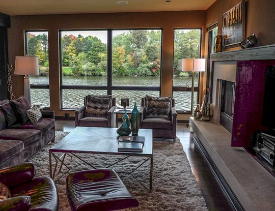 The living room of the Smalley house on Moores River Drive in Lansing has a view of the Grand River.