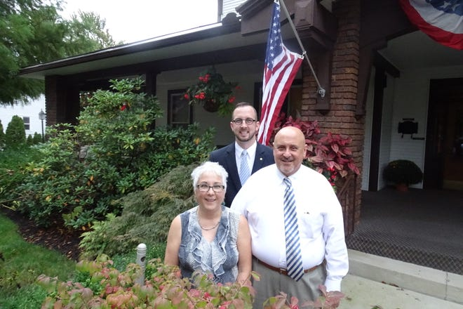 Jake Penwell stands with Catherine and Bob Turner outside the Penwell Turner Funeral Home in Shelby.