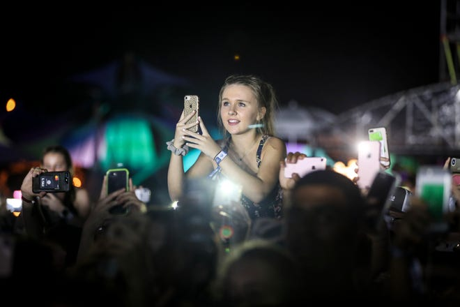 Fans watch Post Malone perform during the Mempho Music Festival at Shelby Farms Park on Sunday, Oct. 7.