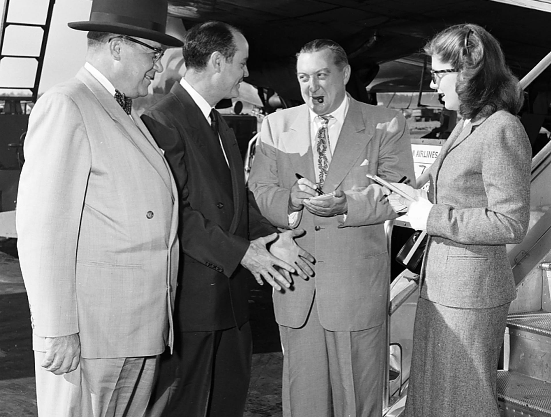Before joining them for an inspection tour of cotton plantations near Greenville, MS in October 1951, Ed Lipscomb (Second Left), director of publications for the National Cotton Council, outlined to his companions what they would see.  Herbert Caterson (Second Right) of the Daily News Record, a cotton journal, and Miss Eleanor Nadler (Right) of Time magazine took notes while John W. Murray (Left) of the American Cotton Manufacturing Institute looked on.