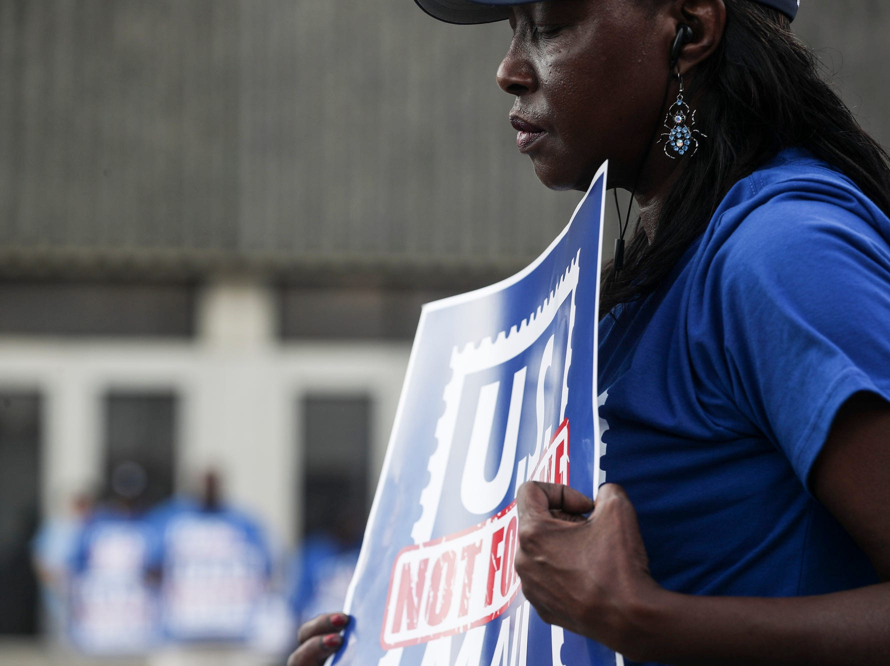 October 08 2018 - Betty Stricklen pauses during a prayer while U.S. Postal Service employees, joined by community supporters, rallied on Monday in front of the Memphis Post Office. Participants sounded an alarm against a proposal announced in June by the White House's Office of Management and Budget to privatize the U.S. Postal Service.