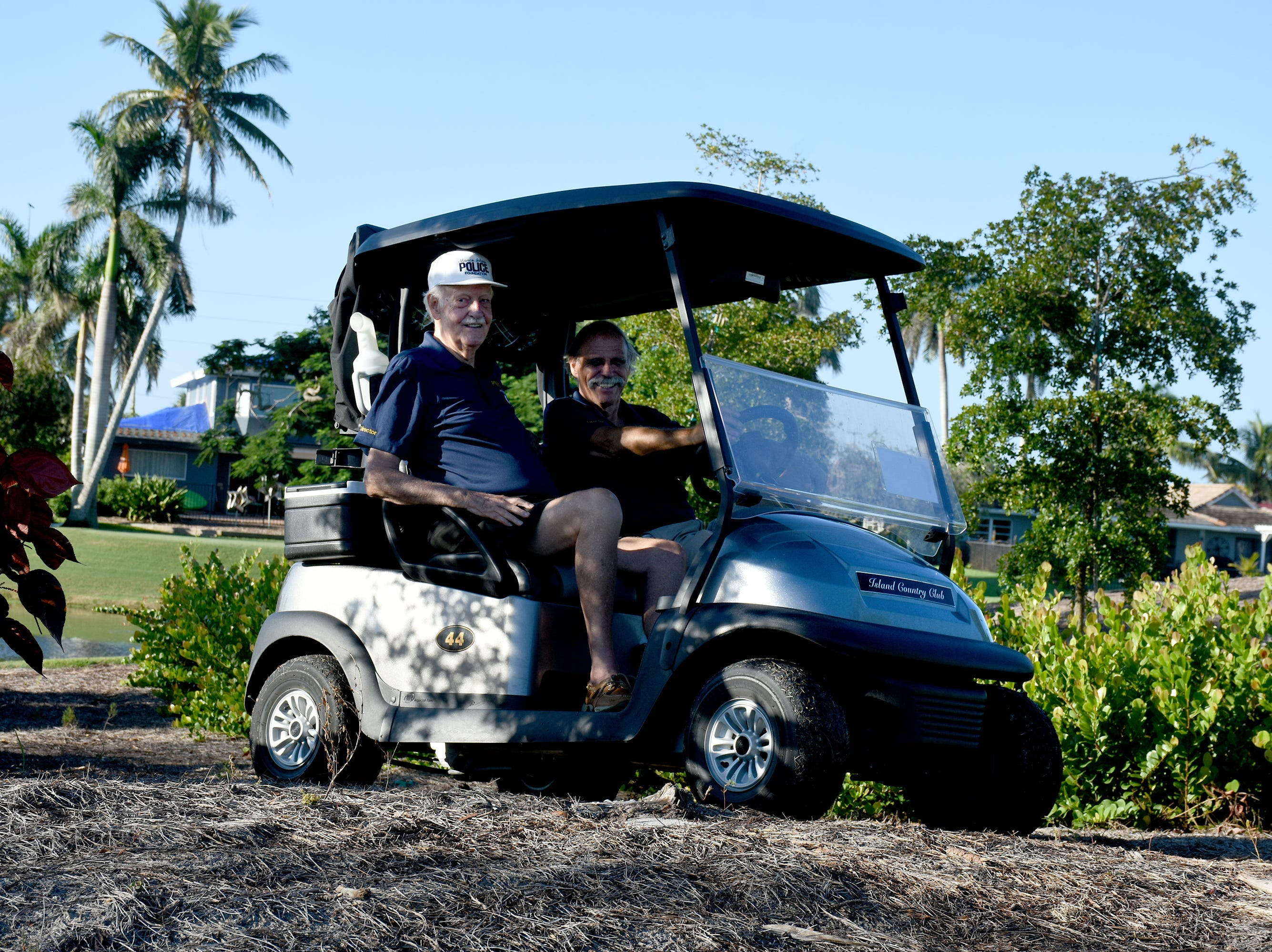 Jack Patterson and Ray McChesney lurk in the shrubbery like a police speed trap while acting as hole in one monitors. The Marco Police Foundation held their annual golf event Saturday morning on the Island Country Club course.