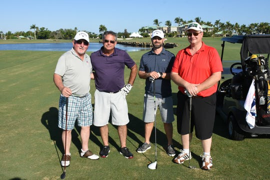 Patrick McGirl, from left, Tracey Smith, Joshua Brown, and Jon Kierczyski pose on the 18th fairway. The Marco Police Foundation held their annual golf event Saturday morning on the Island Country Club course.