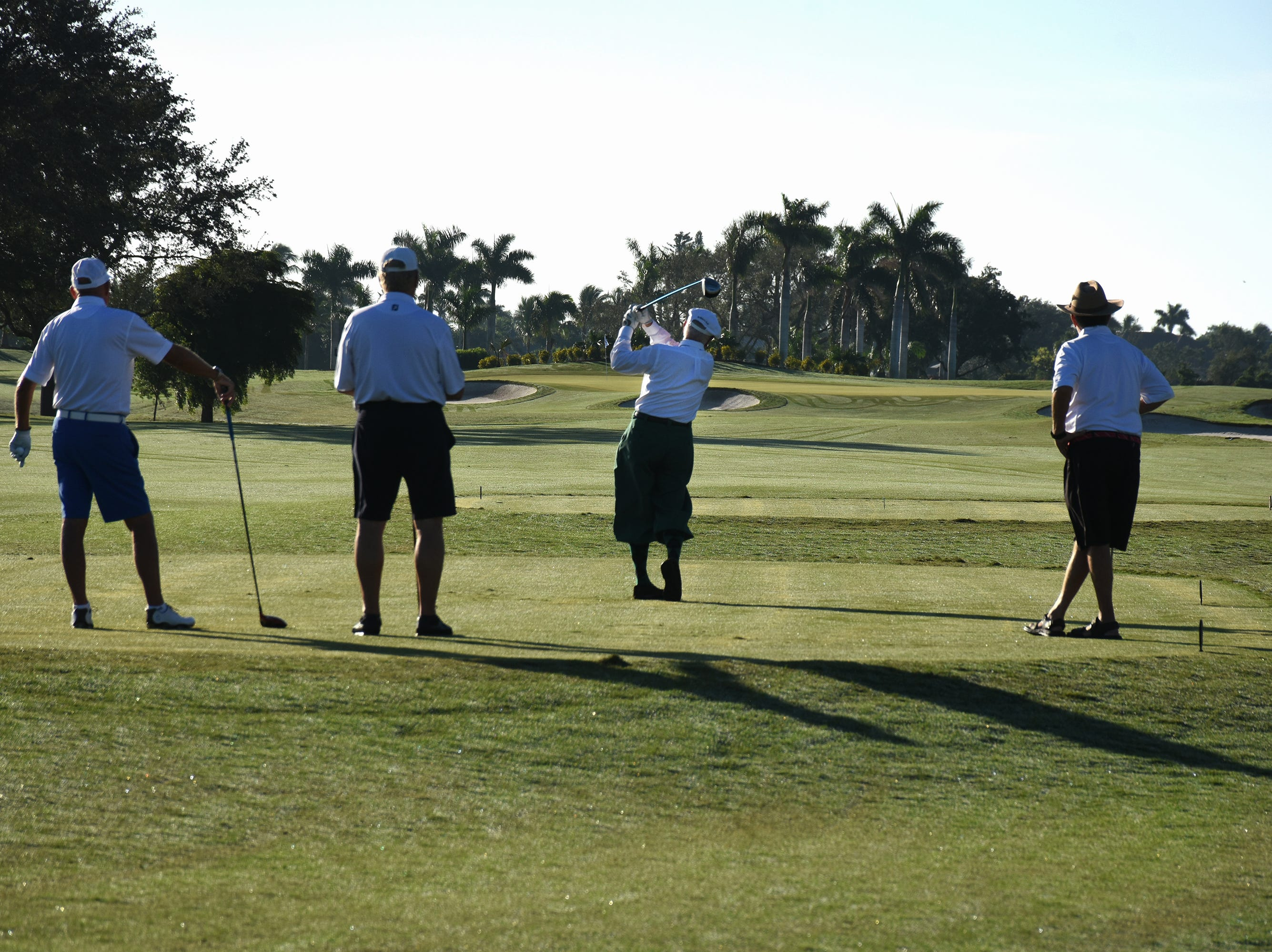 Terry McCreanor tees off in his retro golf togs. The Marco Police Foundation held their annual golf event Saturday morning on the Island Country Club course.