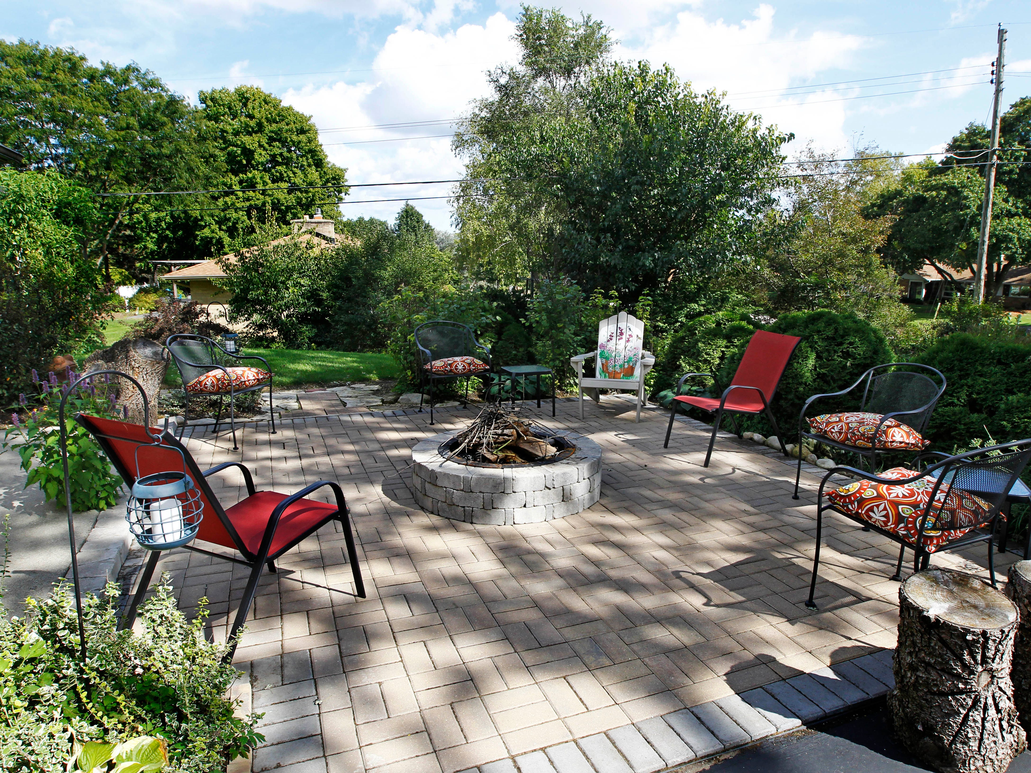 A patio with a fire pit  is a cozy spot for family and friends to gather.