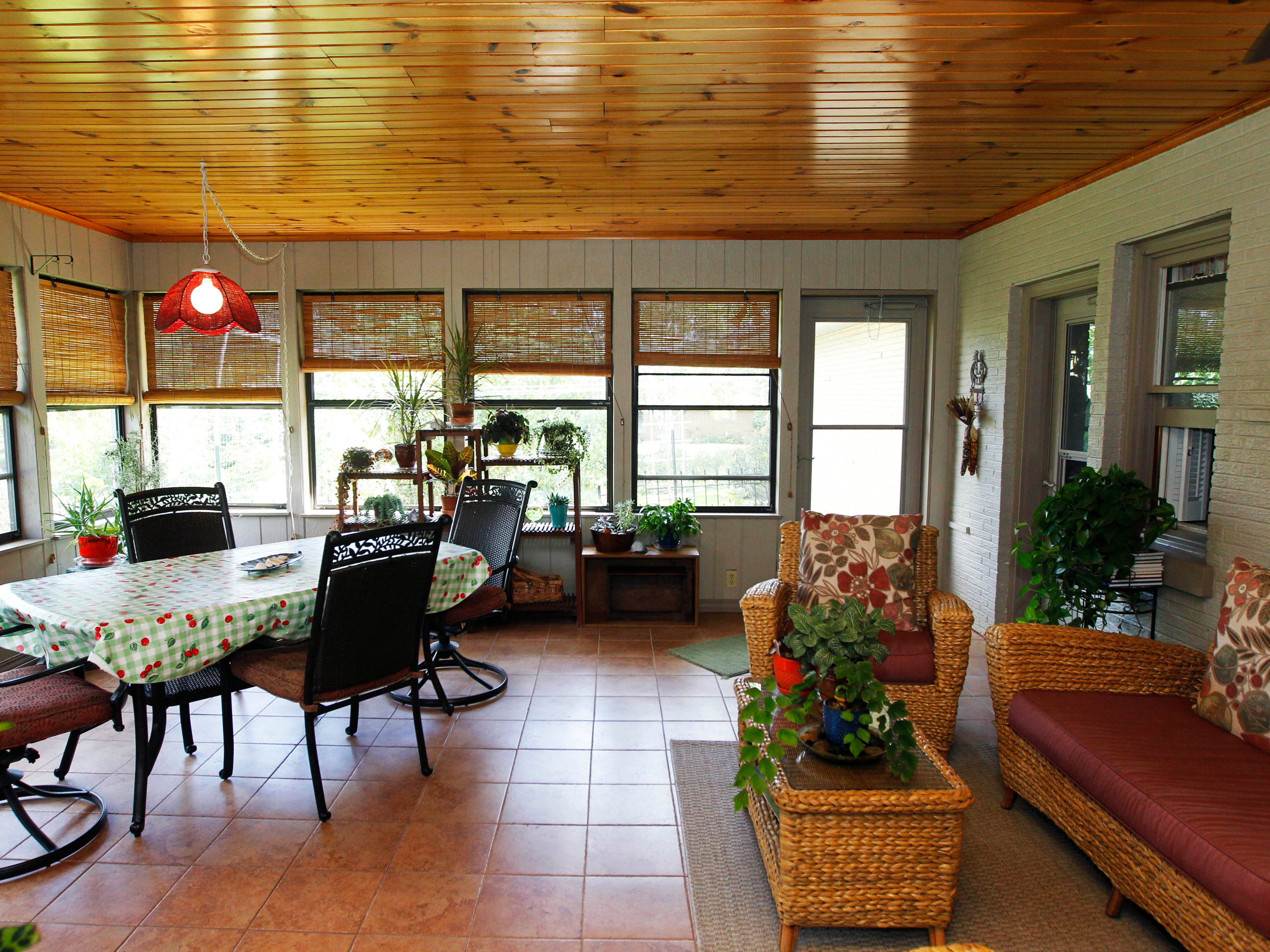 The three season room provides ample light not only for family, but plants as as well.