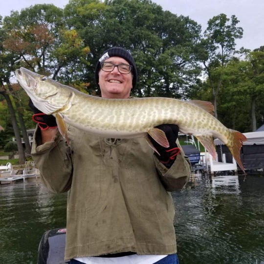 Novice fisherman Brett Hartmann caught a 44-inch muskie on Pewaukee Lake during a recent outing to honor the memory of a friend who died in 2014.