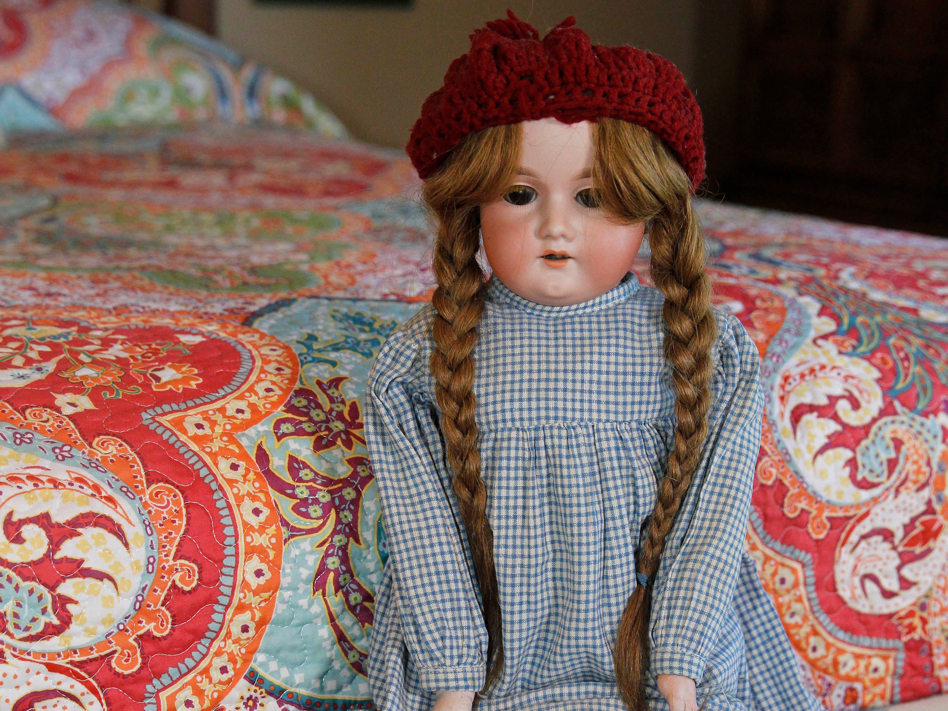 This doll on display, circa 1915, is from Ann Sheahan's grandmother, Sophie Robisch, who added her own hair to the doll.