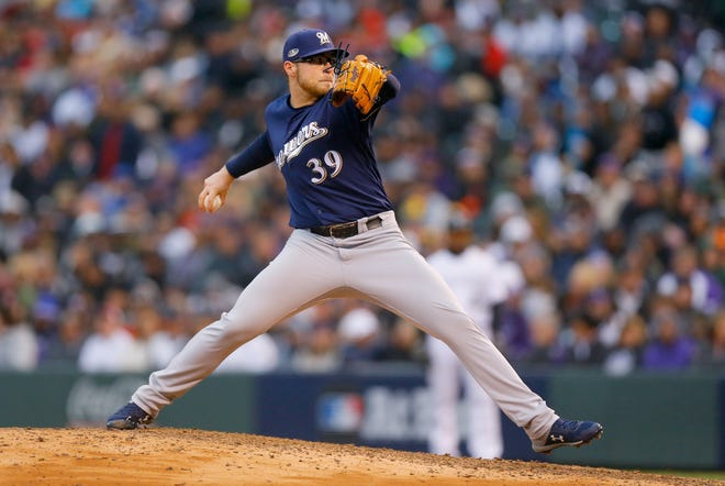 Pitcher Corbin Burnes throws a pitch in the eighth inning on Sunday.