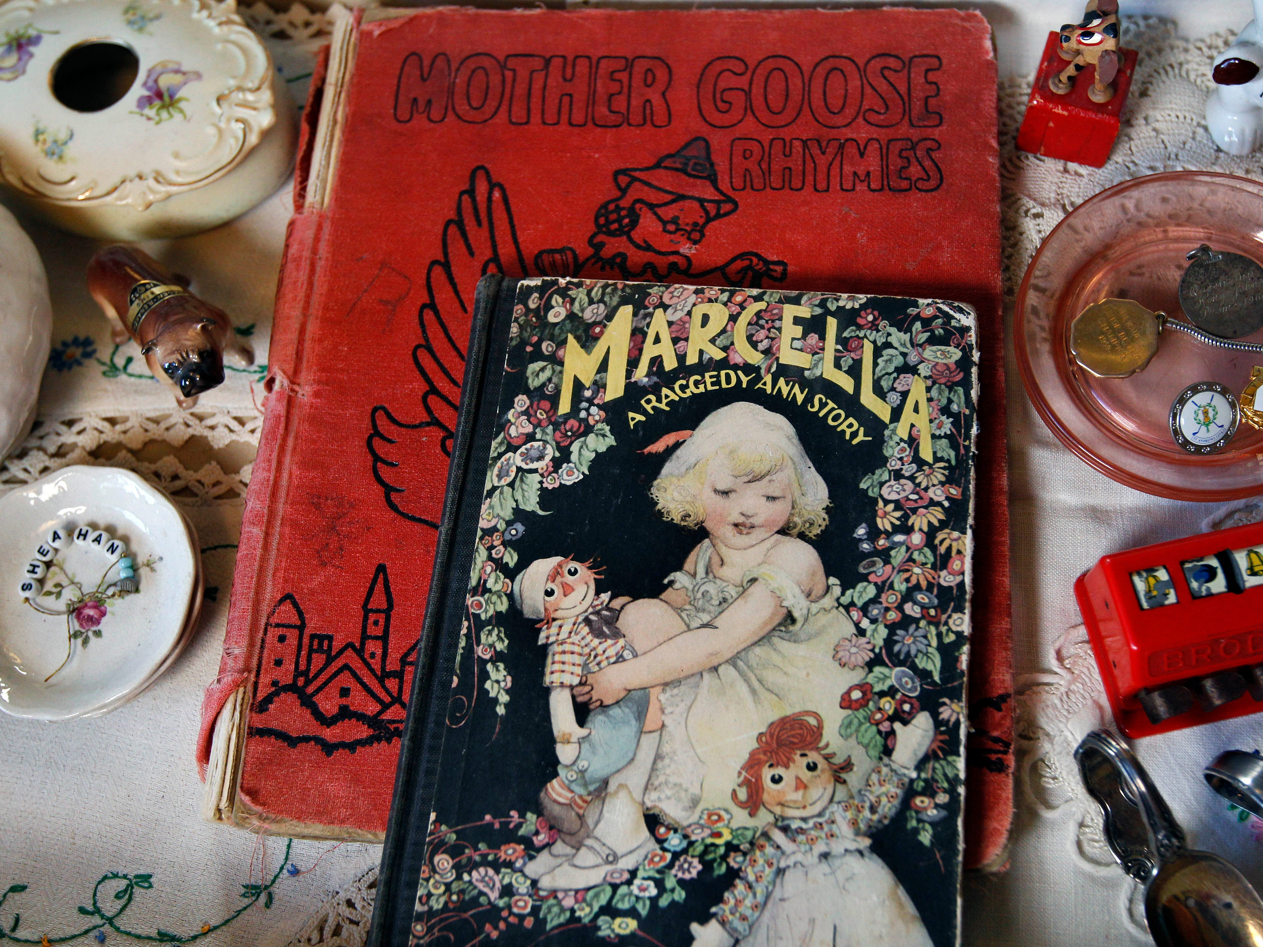 The homeowner's collection of family pieces includes these children's books and toys.