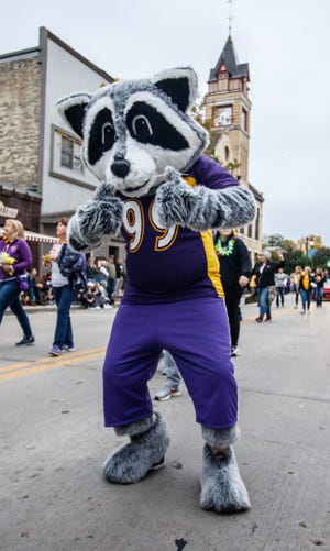 Oconomowoc High School's Rocky Raccoon poses for a photo during the annual homecoming parade in downtown Oconomowoc on Friday, Oct. 5, 2018. The school's homecoming parade that was supposed to take place this year will be postponed until the spring or fall of 2021 due to the COVID-19 pandemic.