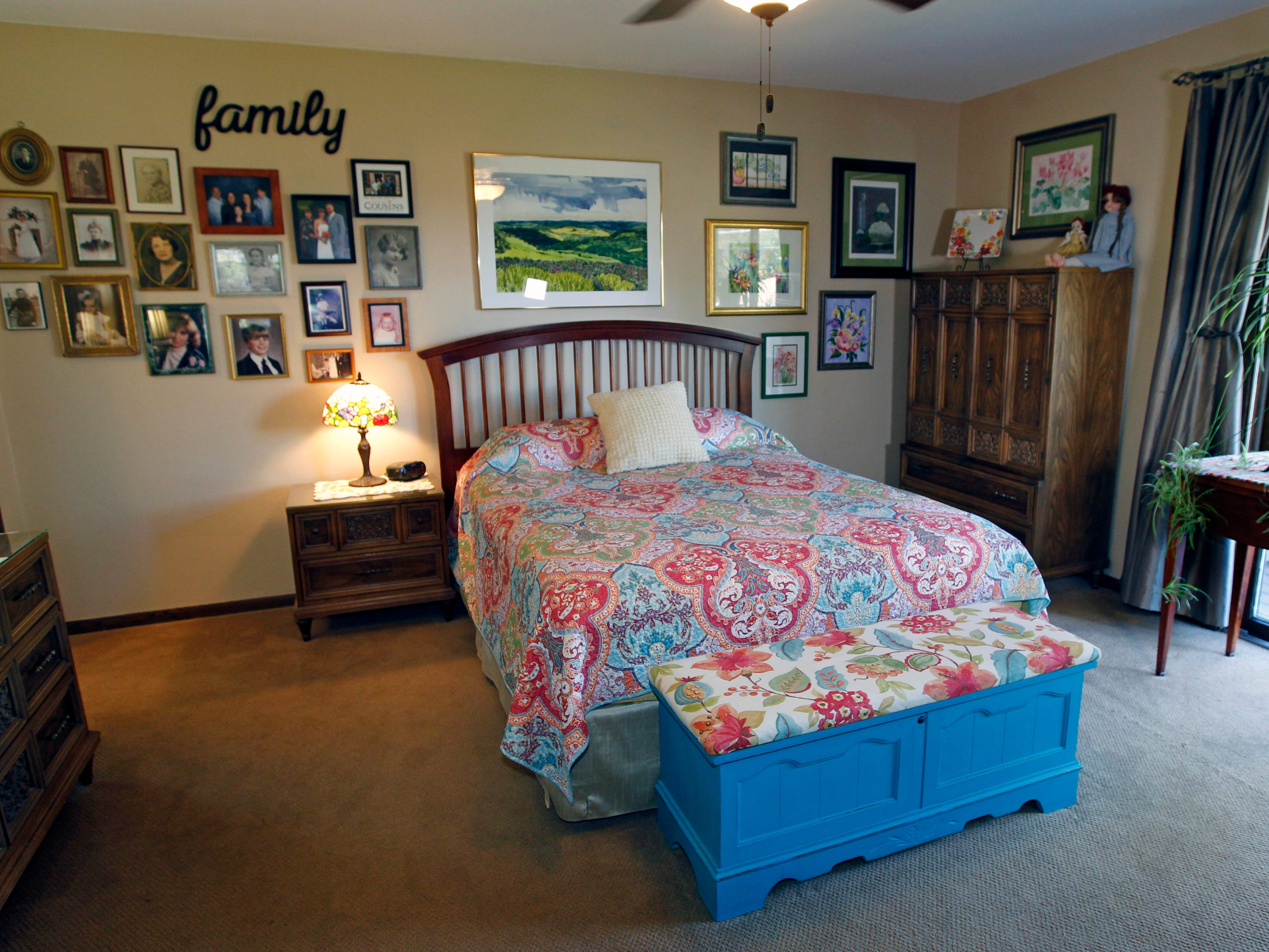 The master bedroom displays family photos and memorabilia.