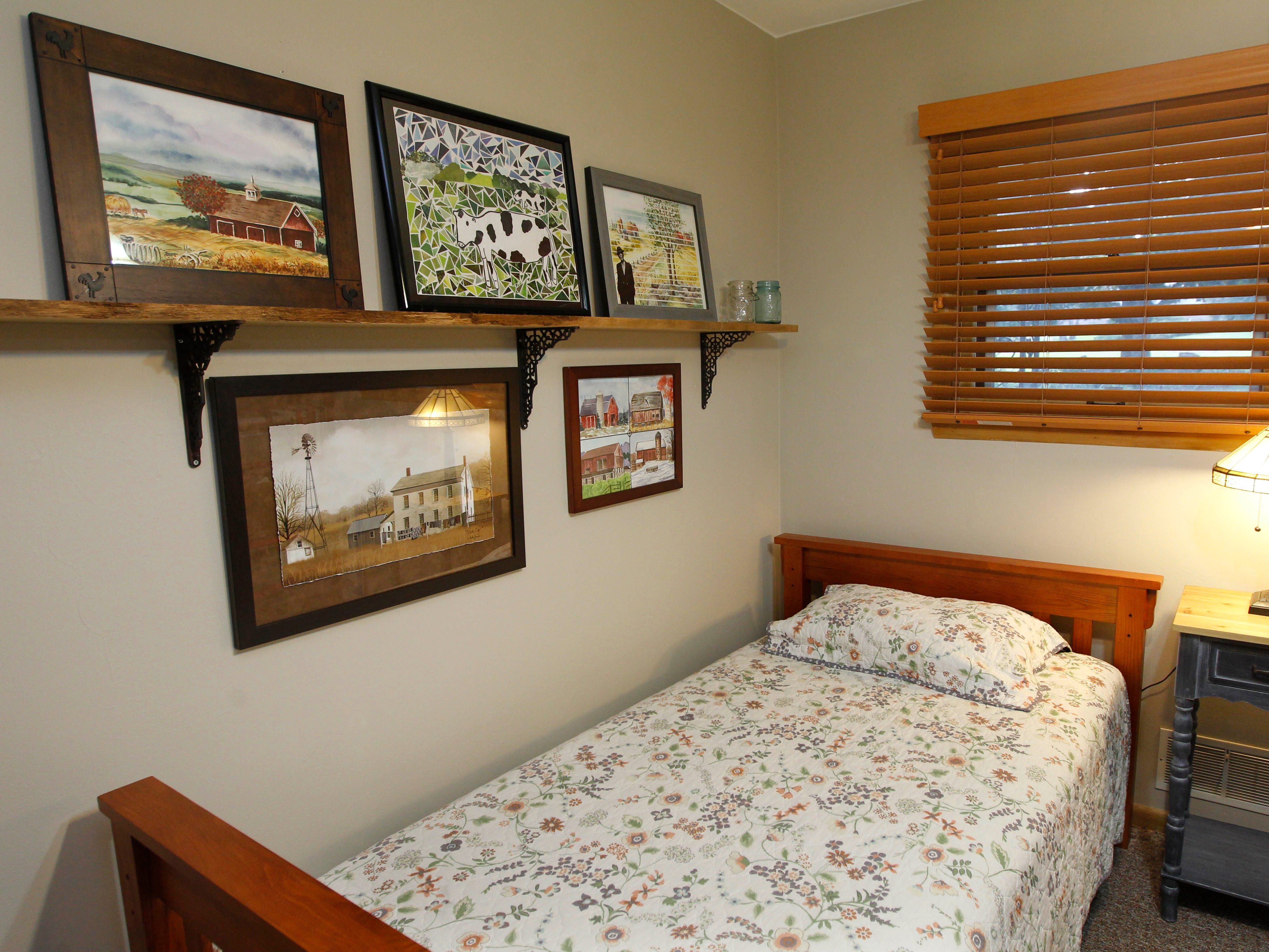 The guest bedroom also displays artwork.