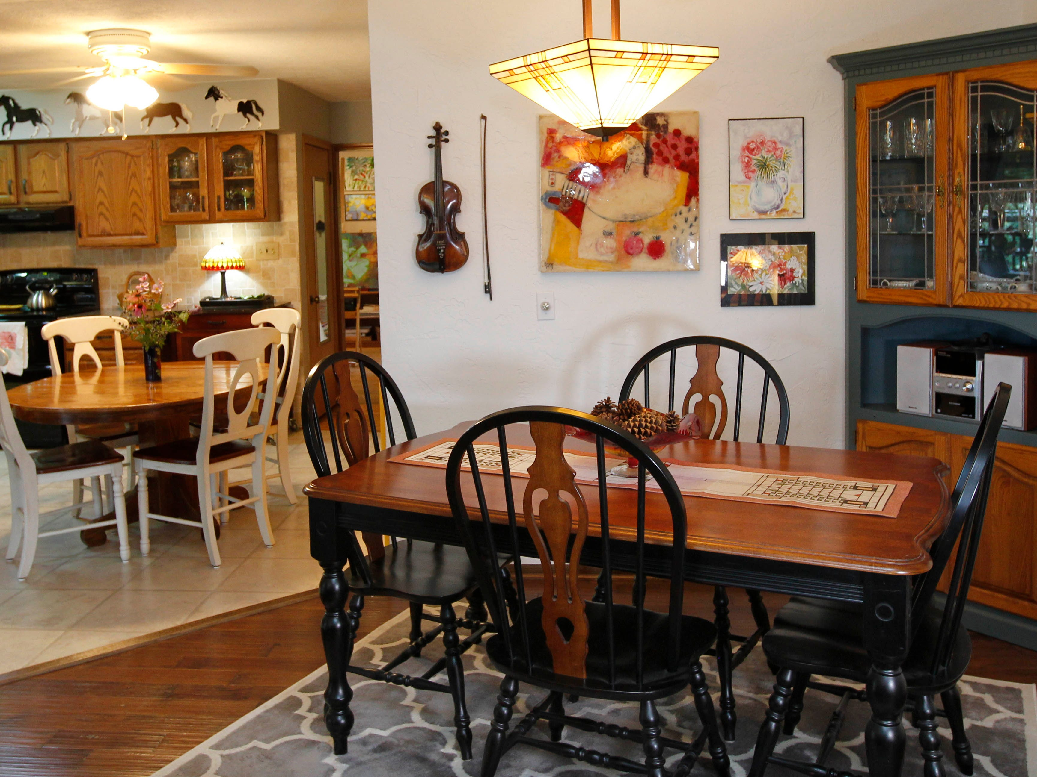 The kitchen and dining room both offer opportunities for dining.
