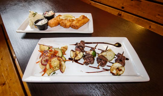 Beer-battered cod with garlic mashed potatoes and the skewers tenderloin appetizer plate with fresh vegetables await hungry customers at Rocky's Hops & Leisure in Oconomowoc during the soft reopening on Friday, Oct. 5, 2018.
